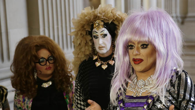 FILE - In this Sept. 17, 2014 file photo, drag queens from left, Lil Ms. Hot Mess, Sister Roma and Heklina, take turns speaking about their battle with Facebook during a news conference at City Hall in San Francisco, Calif. Facebook on Wednesday Oct. 1, 2014 apologized to drag queens and the transgender community for deleting accounts that used drag names like Lil Miss Hot Mess rather than legal names such as Bob Smith. (AP Photo/Eric Risberg, File)