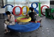 This file photo shows visitors sitting at a lobby of Google Korea office in Seoul, in 2010. Google has confirmed that its online search and advertising services are under scrutiny by regulators in Argentina and S.Korea