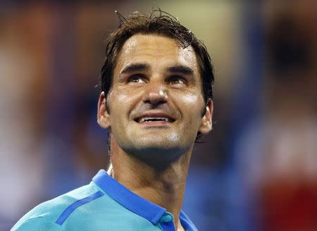 Roger Federer of Switzerland looks up at crowd after defeating Marcel Granollers of Spain in men's singles play following match at 2014 U.S. Open tennis tournament in New York