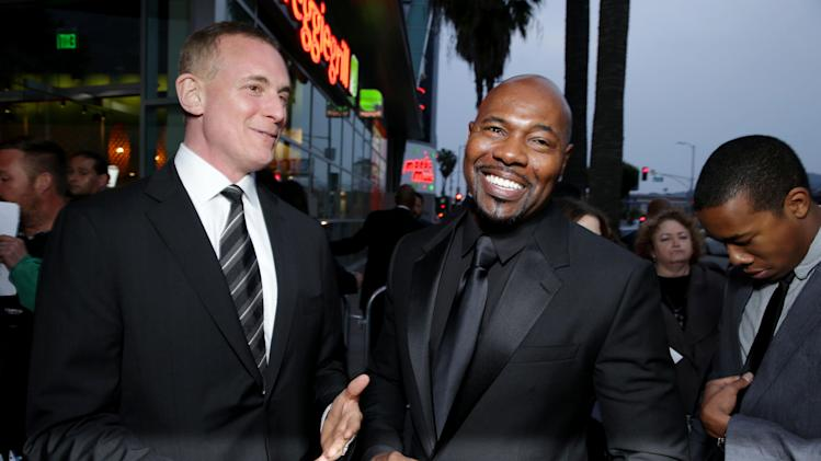 Executive Producer/FilmDistrict's Peter Schlessel and Director Antoine Fuqua at FilmDistrict's Premiere of 'Olympus Has Fallen' hosted by Brioni and Grey Goose at the ArcLight Hollywood, on Monday, March, 18, 2013 in Los Angeles. (Photo by Eric Charbonneau/Invision for FilmDistrict/AP Images)