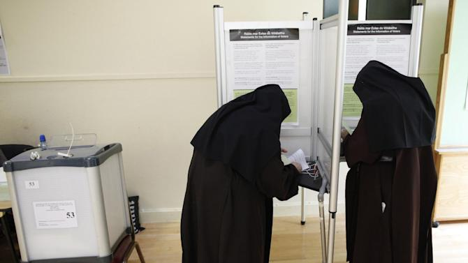 Carmelite sisters prepare to cast their vote at a polling station in Malahide, County Dublin, Ireland, Friday, May 22, 2015.  Ireland began voting Friday in a referendum on Gay marriage which will require an amendment to the Irish constitution.  (AP Photo/Peter Morrison)
