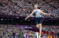 Gold medalist Britain&#39;s Greg Rutherford competes in the men&#39;s long jump final at the athletics event of the London 2012 Olympic Games