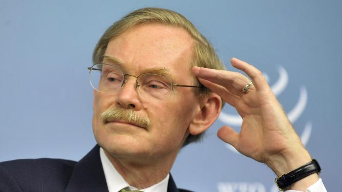 World Bank president Robert Zoellick attends the third Global Review of aid for trade co-hosted by the World Trade Organization (WTO) in Geneva, Switzerland, Monday, July 18, 2011. The World Trade Organisation holds its third review conference on the aid for trade process, launched in 2005 to help poorer countries build trade facilitating infrastructure. (AP Photo/Keystone, Sandro Campardo)   Germany out - Austria out