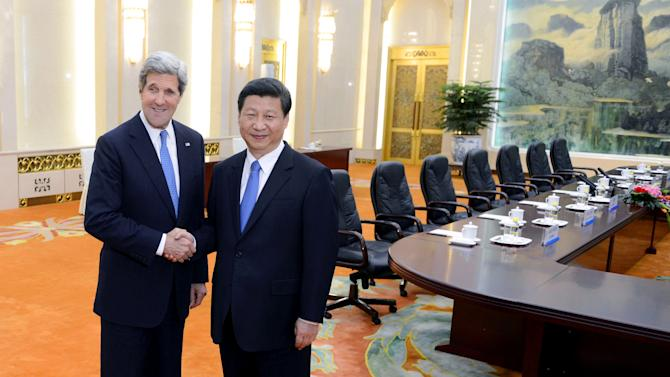 U.S. Secretary of State John Kerry, left, poses with Chinese President Xi Jinping before their meeting at the Great Hall of the People in Beijing Saturday, April 13, 2013. The question of how Washington can persuade Beijing to exert real pressure on North Korean leader Kim Jong Un's unpredictable regime is front and center as Kerry meets Saturday with Chinese leaders in Beijing. (AP Photo/Yohsuke Mizuno, Pool)