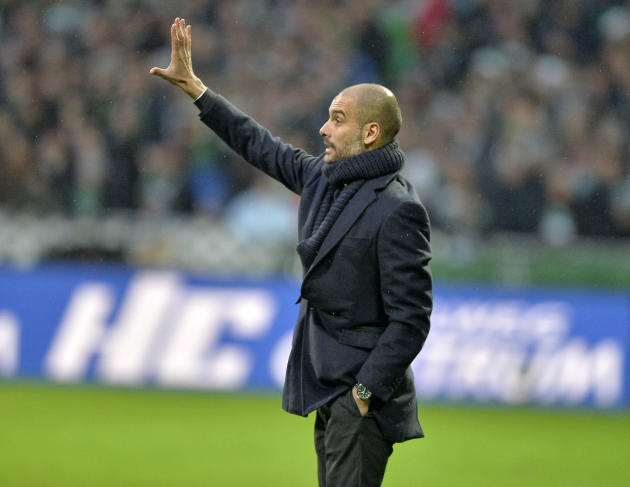 Bayern head coach Pep Guardiola of Spain  communicates with his team during the German Bundesliga soccer match between Werder Bremen and Bayern Munich in Bremen, Germany, Saturday, Dec. 7, 2013