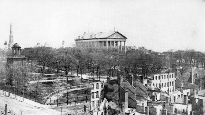 This April 1865 image provided by the Library of Congress shows the view of buildings below the State Capitol in Richmond, Va, which were destroyed by the Confederate evacuation fire of April 2, 1865.  The fall of Richmond  foreshadowed the end of the Civil War and almost 250 years of American slavery. Events are scheduled for April to commemorate the fall of Richmond. (AP Photo/Library of Congress)