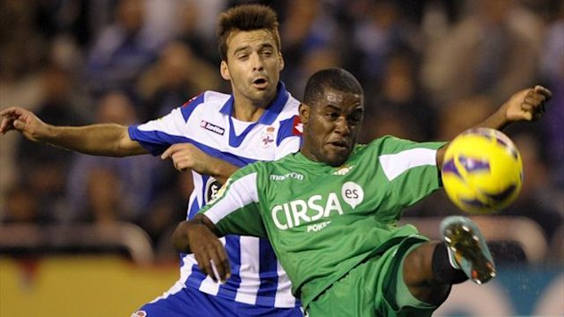 Betis' Costa Rican forward Joel Campbell (R) vies with Deportivo Coruna's Portuguese midfielder Bruno Gama during the Spanish league football match Deportivo vs Betis at Riazor's Stadium in Coruna