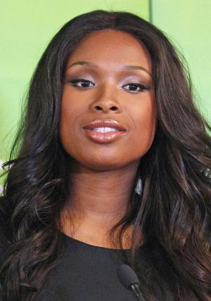 FILE - In this Sept. 27, 2011 file photo, singer and actress Jennifer Hudson speaks in Chicago. Hudson is playing multiple roles at Chicago's Criminal Courts Building, that of celebrity and victim, as well as witness, as she attends the trial of William Balfour, accused in the killings of her three family members. Some accommodations are courtesies routinely extended to non-stars, but some, court spokesmen concede, are on account of her stardom. (AP Photo/M. Spencer Green, File)