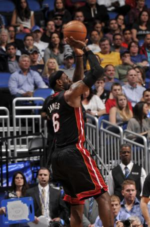 James, Bosh lead Heat over Magic 112-110 in OT