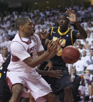 VCU's Jarred Guest ,right and Temple's Khalif Wyatt (1) chase a loose ball in the first half of an NCAA College basketball game, Sunday, March 10, 2013, in Philadelphia. (AP Photo/H. Rumph Jr)