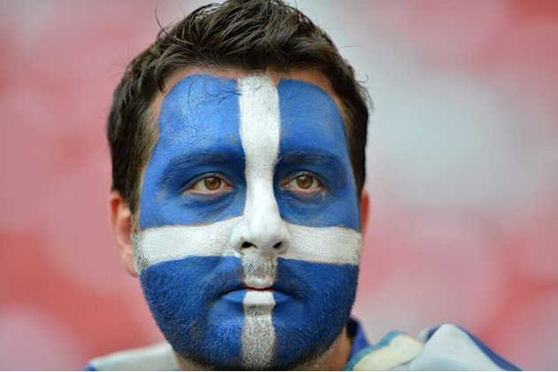 A Greek Fan Waits AFP/Getty Images