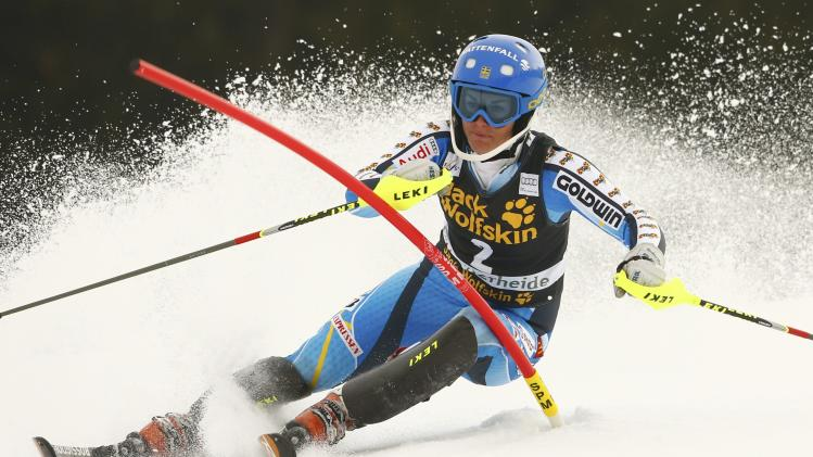 Pietilae-Holmner of Sweden clears a pole during the first run of the women's slalom at the FIS Alpine Skiing World Cup Finals in Lenzerheide