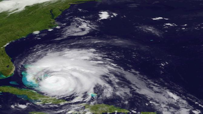 In an image provided by NOAA and made by the GOES East satellite Hurricane Irene is shown as it move over the Bahama Thursday Aug. 25, 2011.  Irene could hit North Carolina's Outer Banks on Saturday afternoon with winds around 115 mph (185 kph) and it's predicted to go up the East Coast, dumping rain from Virginia to New York City. (AP Photo/NOAA)