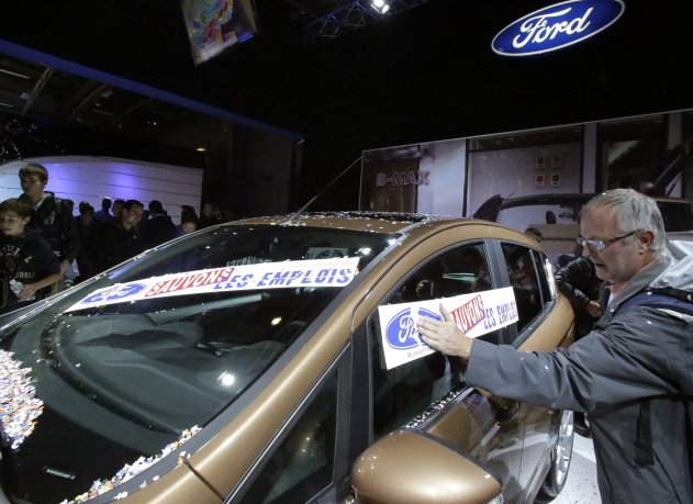 Giant Stickers Become Protest Tool At Auto Show
