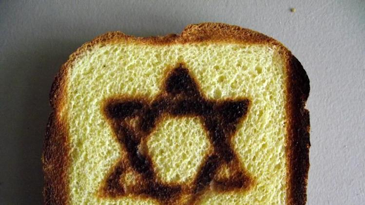 This product image released by BurntImpressions.com shows toast with a Star of David symbol burned into it.  The toast was made by a specialty Star of David Toaster. (AP Photo/BurntImpressions.com)
