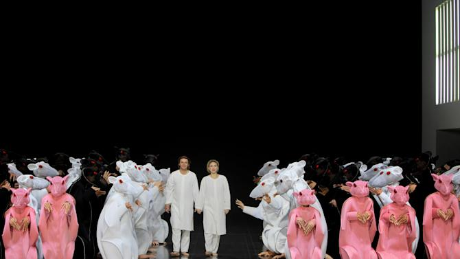 """In this undated handout picture publicly provided by the Bayreuth Festspiele Klaus Florian Vogt, center left, in the role of Lohengrin, and Anette Dasch as Elsa, center right, perform during a rehearsal of the Richard Wagner opera """"Lohengrin"""". (AP Photo/Bayreuth Festspiele, Enrico Nawrath) - MANDATORY CREDIT - EDITORIAL USE ONLY, NO ARCHIVE - NO SALES -"""