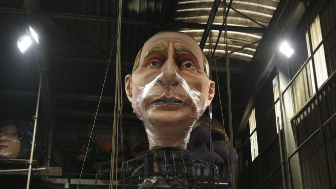 A giant figure of Russian President Vladimir Putin is seen during preparations for the carnival parade in Nice