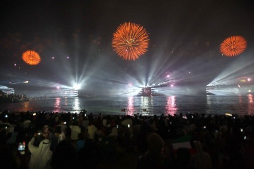 Fireworks light the sky in Kuwait City during celebrations marking the 50th anniversary of the country's constitution