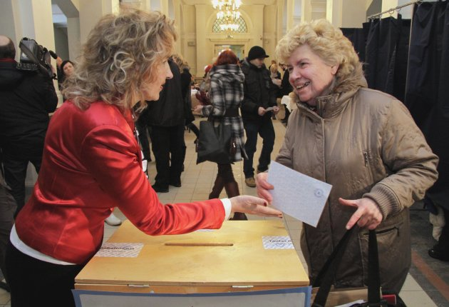 A Latvian woman casts her ballot paper at a polling station during a language referendum in Riga, Latvia, Saturday, Feb. 18, 2012. Latvia on Saturday opened a referendum on whether Russian should become the Baltic country's second national language, a poll that is likely to fail and widen the rift in an already divided society.