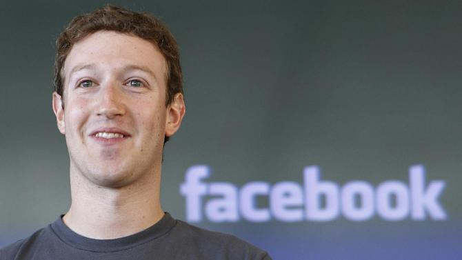 "FILE - This Oct. 15, 2011 file photo, shows Facebook CEO Mark Zuckerberg smiling during a meeting in San Francisco. Will Facebook list its stock on the New York Stock Exchange or the Nasdaq? It comes down to ""where Mark Zuckerberg wants to get his picture taken,""  the founder of one market research company says.  (AP Photo/Paul Sakuma, File)"