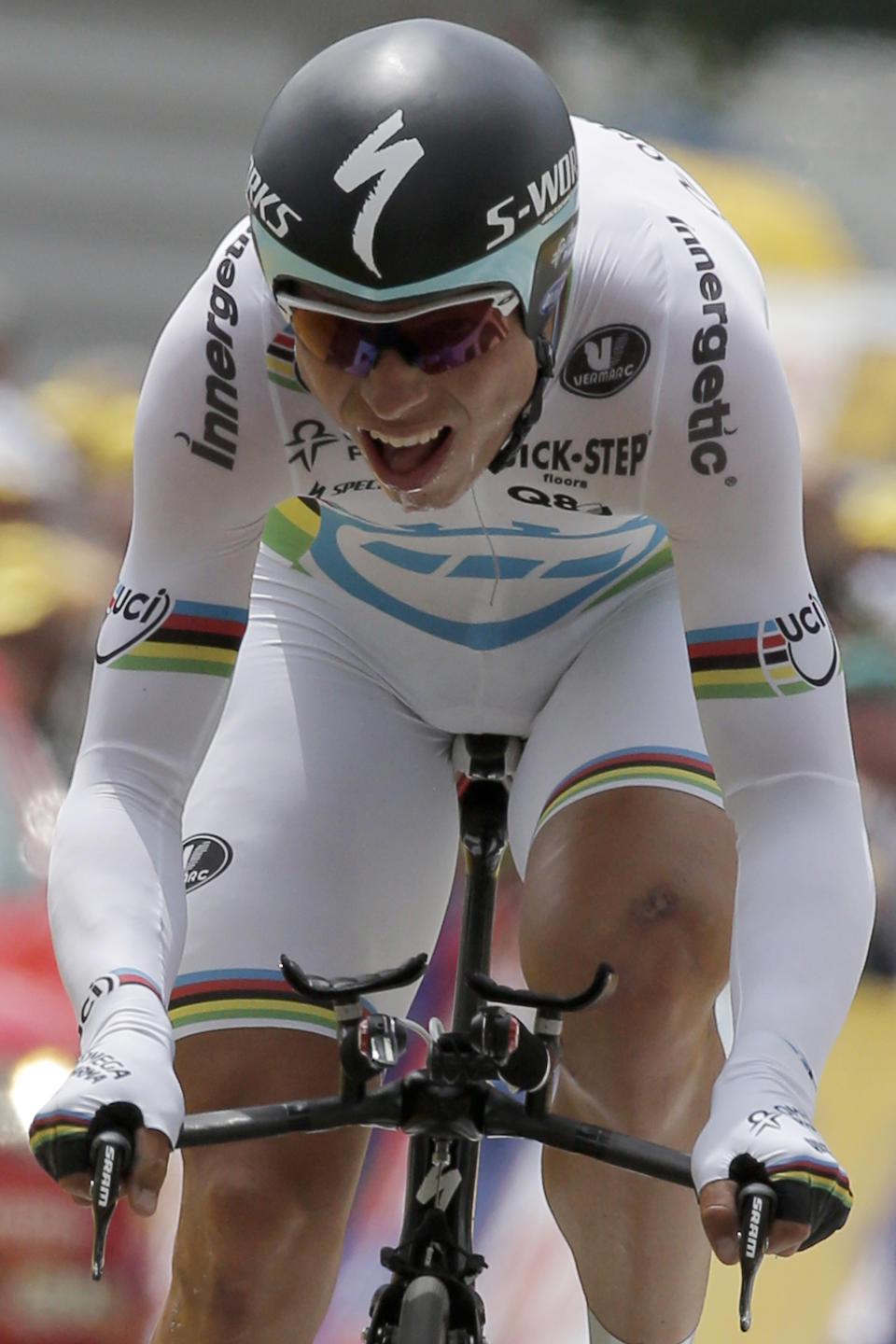 Tony Martin of Germany strains in the last meters of the 9th stage of the Tour de France cycling race, an individual time trial over 41.5 kilometers (25.8 miles) with start in Arc-et-Senans and finish in Besancon, France, Monday July 9, 2012. (AP Photo/Laurent Rebours)