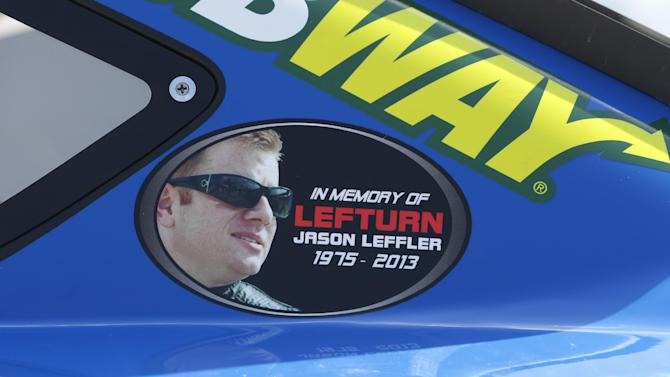 A Jason Leffler sticker is seen on Carl Edwards' car after qualifying, Friday, June 14, 2013 for Sunday's Quicken Loans 400 auto race at Michigan International Speedway in Brooklyn, Mich. The death of NASCAR driver Leffler at a dirt-track race near Philadelphia earlier this week has brought more attention to small, local tracks, where some big names like Tony Stewart still show up to race on occasion. (AP Photo/Carlos Osorio)