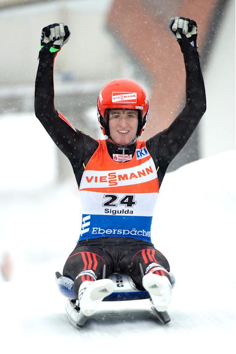 Natalie Geisenberger of Germany celebrates after winning the womens luge World Cup event in the Latvian town of Sigulda on February 19, 2012. AFP PHOTO /ILMARS ZNOTINS (Photo credit should read ILMARS