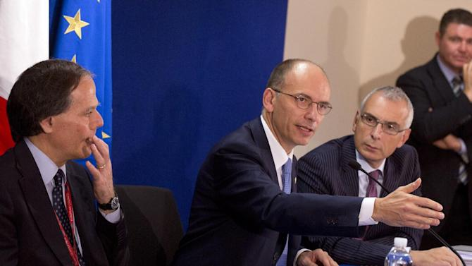 Italian Prime Minister Enrico Letta, center, gestures while speaking during a media conference after an EU summit in Brussels on Friday, Oct. 25, 2013. Migration, as well as an upcoming Eastern Partnership summit, topped the agenda in Friday's meeting of EU leaders. (AP Photo/Virginia Mayo)