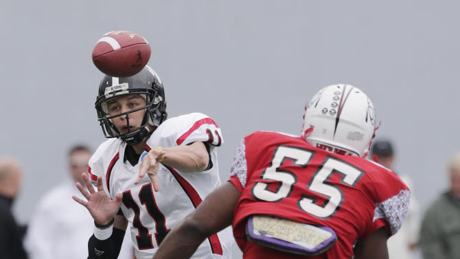 Valdosta State quarterback Cayden Cochran (11) is pursued by Winston Salem State's Mareece Harris (55) as he throws a pass in the first half of an NCAA Div II national championship college football game at Braly Municipal Stadium in Florence, Ala., Saturday, Dec. 15, 2012. (AP Photo/Dave Martin)