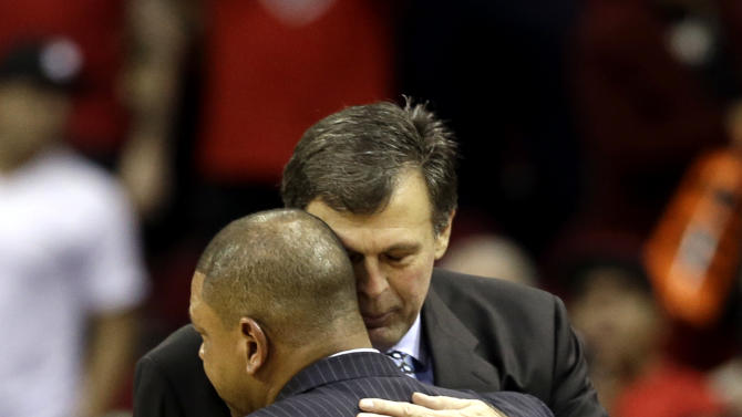 Houston Rockets coach Kevin McHale, right, is hugged by Boston Celtics coach Doc Rivers after an NBA basketball game Friday, Dec. 14, 2012, in Houston. McHale's daughter died recently. The Rockets beat the Celtics 101-89. (AP Photo/David J. Phillip)