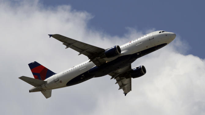 This Monday, Aug. 20, 2012, photo, shows a Delta Airlines aircraft taking off at Miami International Airport in Miami. Delta Air Lines said Wednesday, Oct. 24, 2012, that its third-quarter profit nearly doubled mostly due to the increasing value of its fuel contracts. (AP Photo/Alan Diaz)
