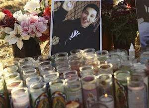 A photo of Andy Lopez Cruz is shown at a makeshift memorial at the site of his death in Santa Rosa