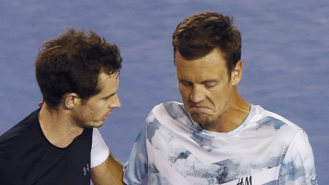 Murray of Britain and Berdych of Czech Republic react following Murray's win over Berdych in their men's singles semi-final match at the Australian Open 2015 tennis tournament in Melbourne