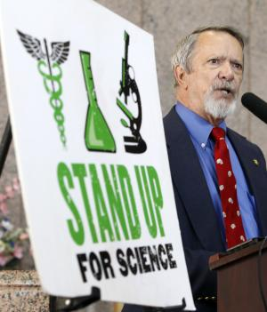 Professor Ron Wetherington speaks at a news conference outside a Texas Board of Education meeting, Thursday, July 21, 2011, in Austin, Texas. The group was speaking in support of  science over ideology. (AP Photo/Eric Gay)