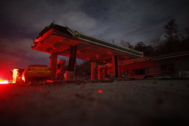 A damaged gas station is seen in the wake of a tornado at West Liberty
