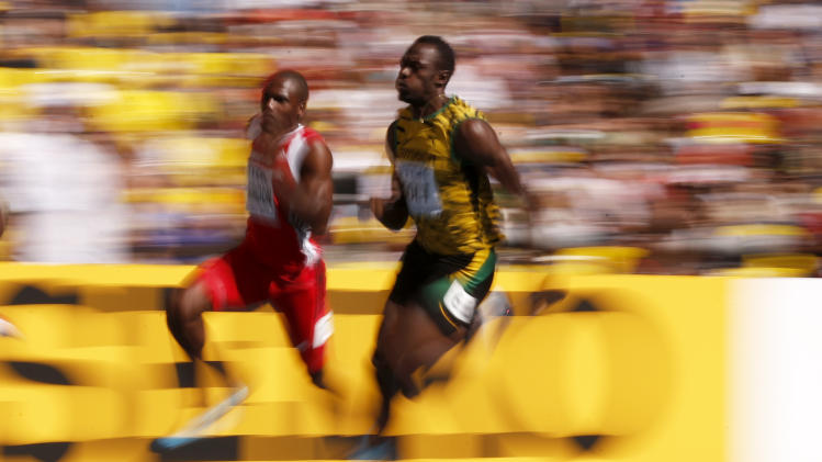 This image made with a long exposure shows Jamaica's Usain Bolt, right, and Trinidad and Tobago's Lalonde Gordon in a men's 200-meter heat at the World Athletics Championships in the Luzhniki stadium in Moscow, Russia, Friday, Aug. 16, 2013. (AP Photo/Matt Dunham)