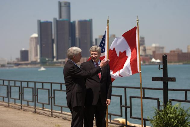 FILE - In this June 15, 2012 file photo, Canada Prime Minister Stephen Harper right, and Michigan Governor Rick Snyder chat on the banks of the Detroit River in Windsor, Ontario, Canada. The omission