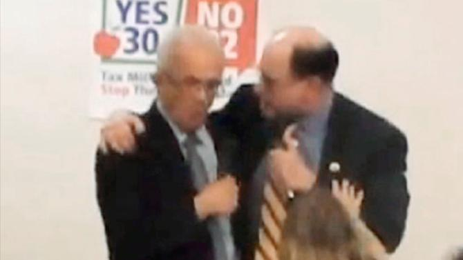 """This image from Thursday evening, Oct. 11, 2012 video provided by a Howard Berman campaign videographer shows Brad Sherman, right, putting his right arm around Howard Berman during a debate at Pierce College in Los Angeles. Sherman seized the shoulder of Berman, brought him toward his chest and shouted, """"You want to get into this?"""" The physical confrontation between the two veteran Democratic House members vying for the same Los Angeles-area congressional seat is the latest example of a campaign that has become increasingly bitter and personal. (AP Photo/Brandon Hall)"""