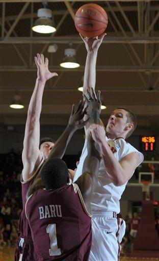 Elon squanders lead, edges Charleston 99-98 in 2OT