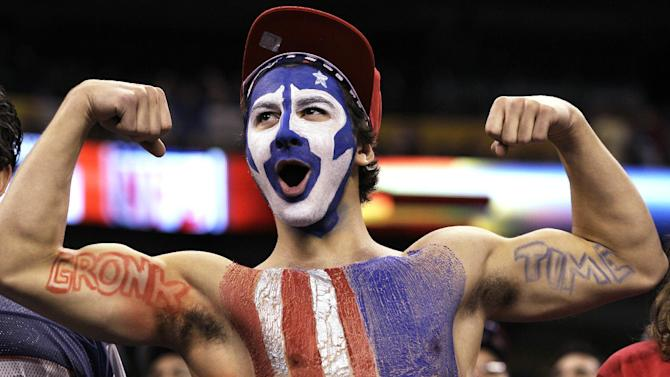 A fan cheers before the NFL Super Bowl XLVI football game between the New York Giants and the New England Patriots, Sunday, Feb. 5, 2012, in Indianapolis. (AP Photo/Mark Humphrey)