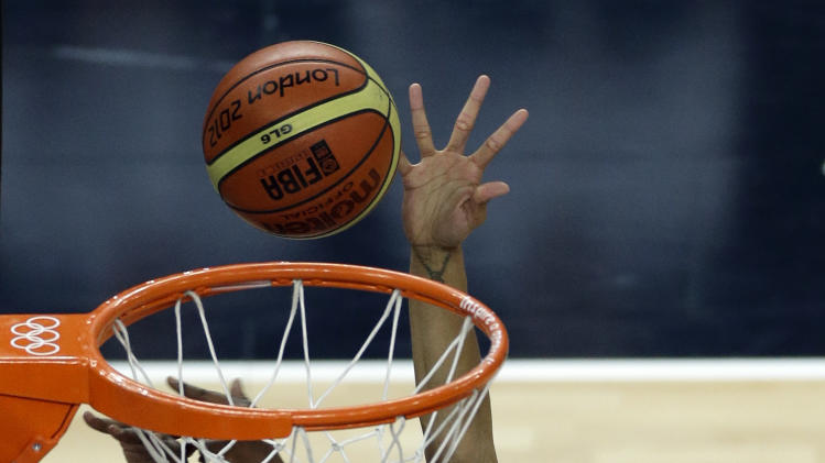 United States' Candace Parker (15) shoots for the basket past France's Endene Miyem during a women's gold medal basketball game at the 2012 Summer Olympics, Saturday, Aug. 11, 2012, in London. (AP Photo/Victor R. Caivano)