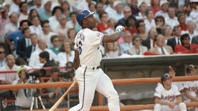 FILE - This July 11, 1989, file photo shows Kansas City Royals'  Bo Jackson watching the flight of his first-inning home run during the All-Star Game, in Anaheim, Calif. Jackson was an All-Star major leaguer and a Pro Bowler in the NFL. (AP Photo/Leonard Ignelzi, File)
