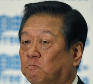 In this photo taken Thursday, Feb. 10, 2011, Ichiro Ozawa, power broker of the ruling Democratic Party of Japan, bites his lips during a press conference in Tokyo. Prosecuting lawyers Wednesday, May 9, 2012, appealed a lower court acquittal of Ozawa in a funding scandal. The appeal prolongs the veteran lawmaker's status as criminal defendant for months, if not years. The Tokyo District Court last month found Ozawa not guilty of violating political funding law related to a 2004 land deal. (AP Photo/Shizuo Kambayashi)