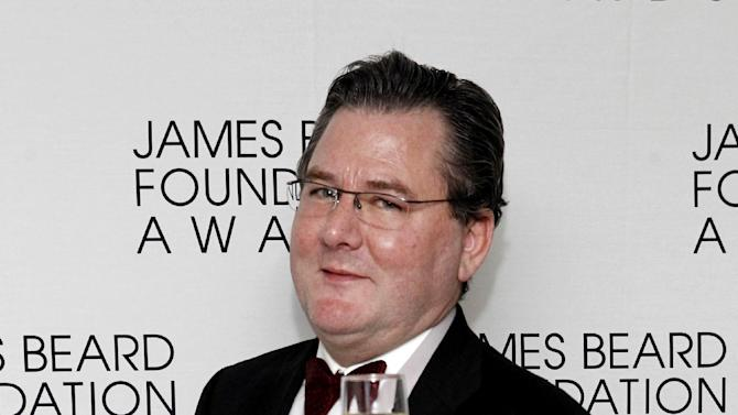 Chef Charlie Trotter poses with his medal for Humanitarian of the Year, during the James Beard Foundation Awards, Monday, May 7, 2012, in New York. (AP Photo/Jason DeCrow)