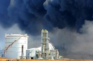 Smoke billows from fires raging at the port in Tagajo, Miyagi prefecture. Japan raced to avert a meltdown of two reactors at a quake-hit nuclear plant Monday as the death toll from the disaster on the ravaged northeast coast was forecast to exceed 10,000