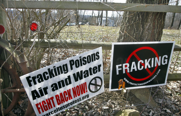 FILE - In this Feb. 23, 2012 file photo, signs opposing the hydraulic fracturing process of drilling for gas, or &quot;fracking&quot; are posted in Evans City, Pa. The Obama administration said Friday it will for the first time require companies drilling for oil and natural gas on public and Indian lands to publicly disclose chemicals used in hydraulic fracturing operations. The proposed &quot;fracking&quot; rules also set standards for proper construction of wells and wastewater disposal. (AP Photo/Keith Srakocic, File)
