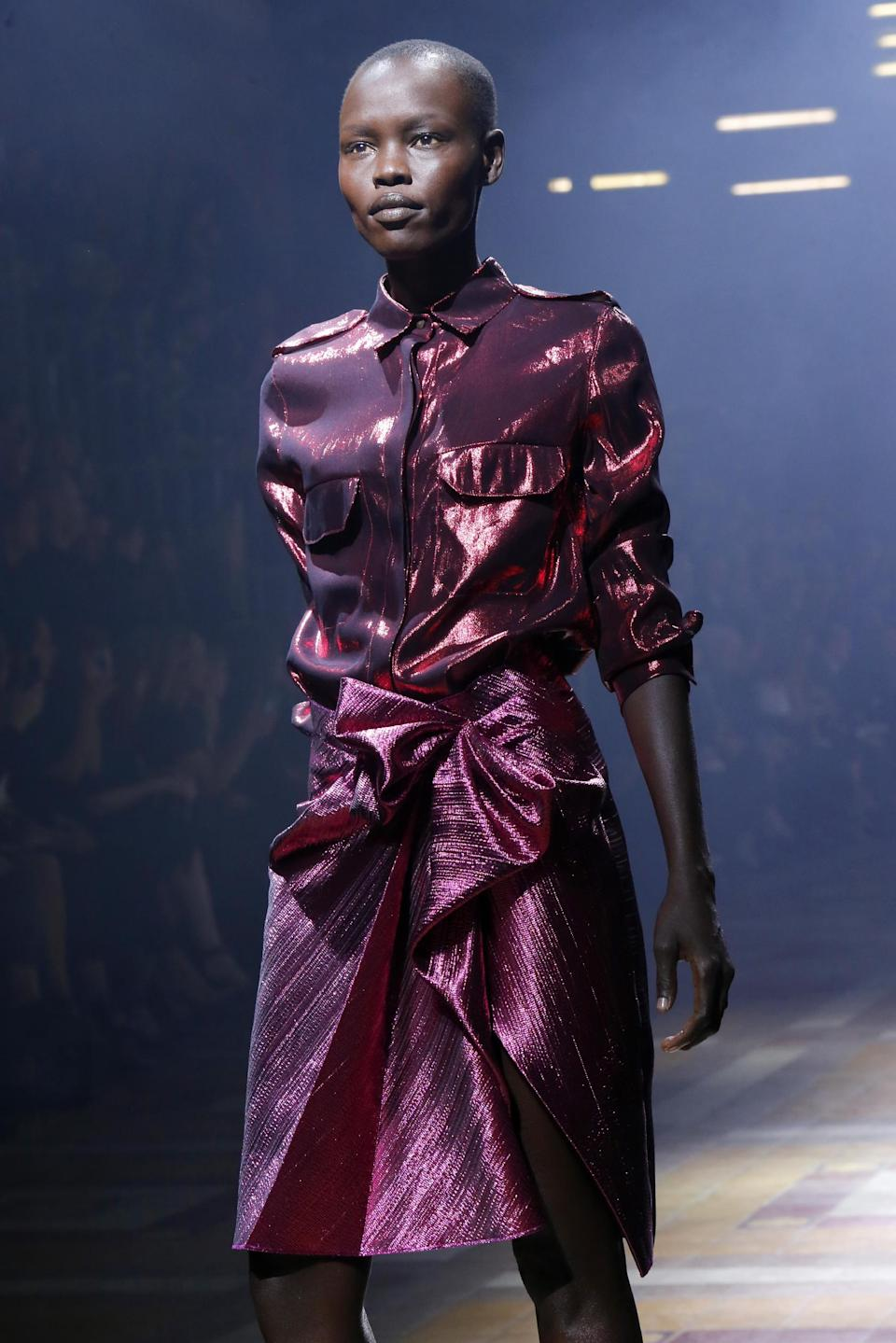 Model Alek Wek presents a creation as part of Lanvin's ready-to-wear Spring/Summer 2014 fashion collection, presented Thursday, Sept. 26, 2013 in Paris. (AP Photo/Jacques Brinon)