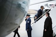 US President Barack Obama boards Air Force One at Andrews Air Force Base in Maryland. Obama's campaign intensified attacks Sunday on Mitt Romney's honesty as it tried to halt the Republican challenger's momentum after a strong first debate performance