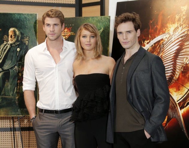 From left, actors Liam Hemsworth, Jennifer Lawrence and Sam Claflin pose for photographers during a photo call for the film The Hunger Game: Catching Fire at the 66th international film festival, in C