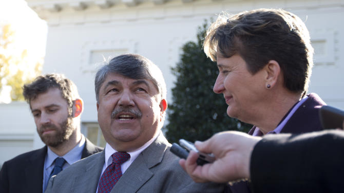 AFL-CIO President Richard Trumka, center, accompanied  by Justin Ruben, executive director of MoveOn.org, left, and Mary Kay Henry, International President of the Service Employees International Union, speaks to reporters outside the White House in Washington, Tuesday, Nov. 13, 2012, after a meeting between business leaders and President Barack Obama to discuss the economy and deficit.  (AP Photo/Carolyn Kaster)